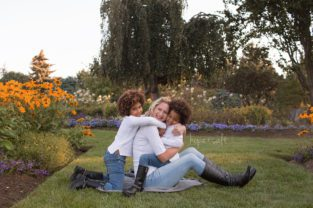 A family session to celebrate a little girl's 4th birthday with two sisters and their mom in local flower garden - burlington family photographer hope + salt
