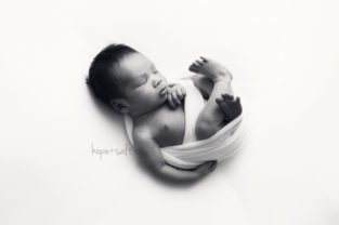 oakville newborn photographer - 12 day old baby boy nathan studio session in simplistic minimalistic with all white backgrounds by Hope + Salt Photography