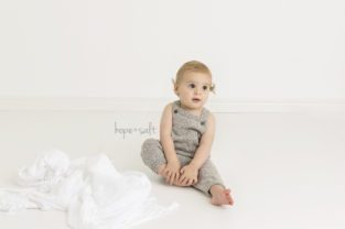 a clean and simple first birthday session in studio for baby boy Grant and family by Burlington newborn photographer Hope + Salt