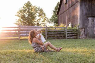 an outdoor farm session outdoor farm session for mom dad baby girl and toddler boy with horses by burlington family photographer Hope + Salt