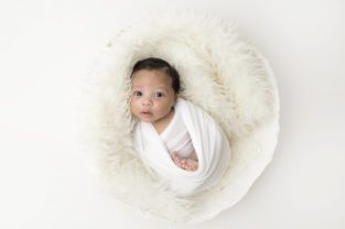 a pure and simple studio session for one month old boy Xavier by Burlington baby Photographer Hope + Salt in all whites and neutrals