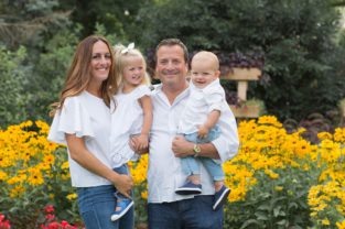 oakville family photographer - a mom dad daughter and toddler boy in flower garden late summer by Hope and Salt Photography