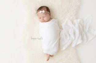 burlington newborn photographer - three week old baby girl Liv simple naturally posed images in studio